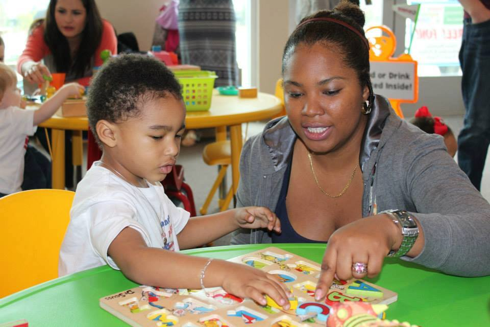 Mother helping her son to learn, Studer Community Institute