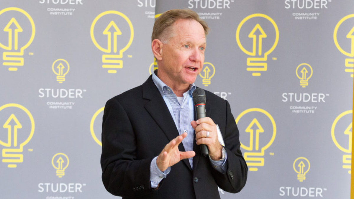 Quint Studer speaking to a crowd