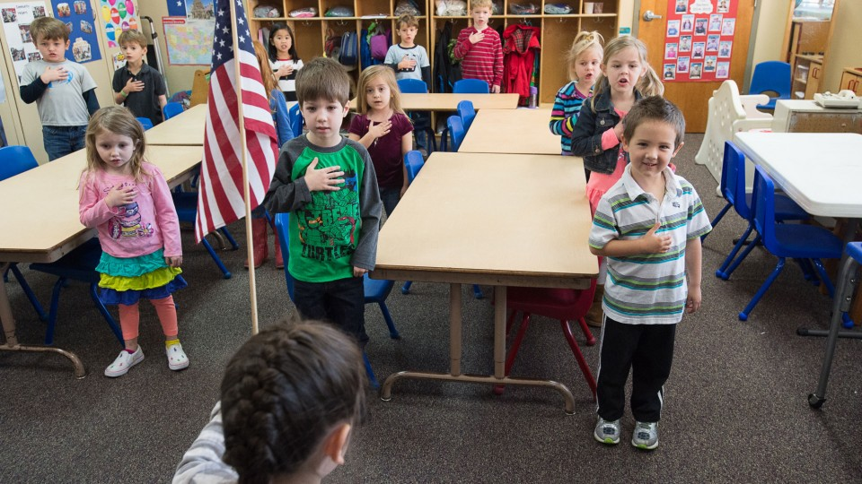 Children in class repeating Pledge of Alligiance