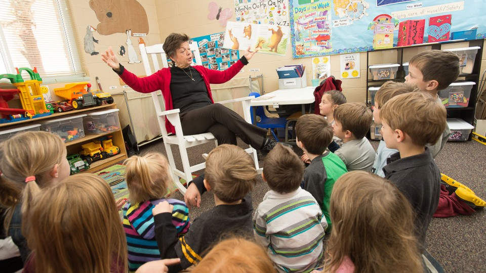 Sandy Lyons reads to VPK students at Trinity Learning Center daycare