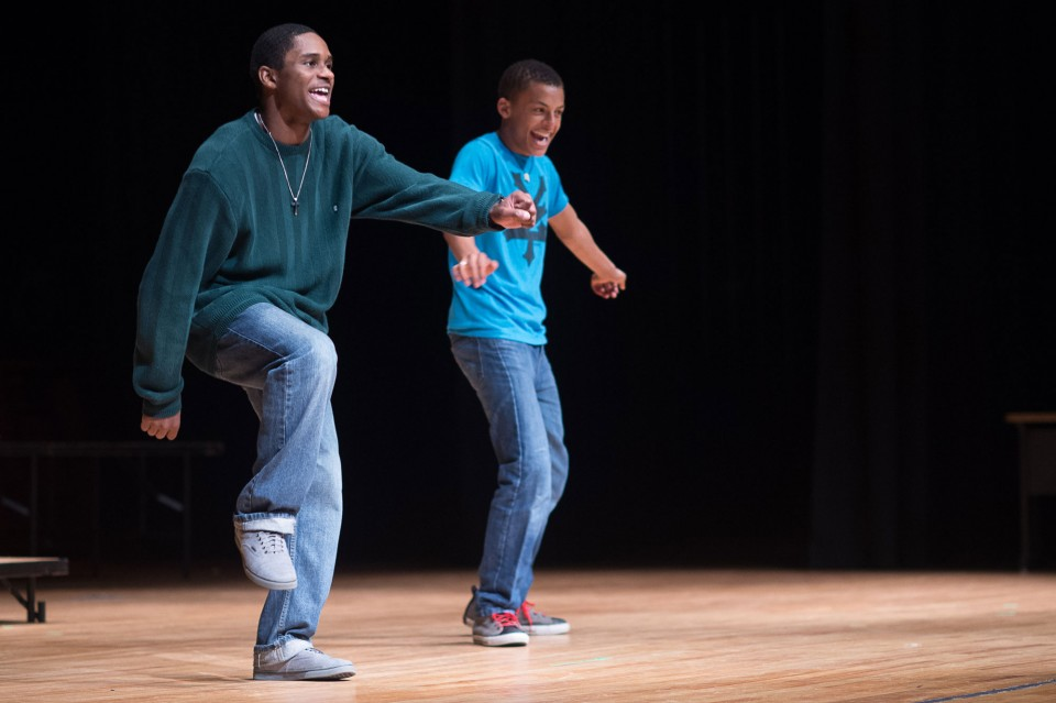 Two black teenagers dancing on stage