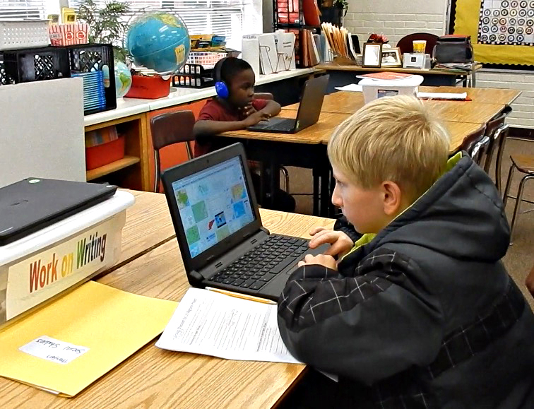Lincoln Park Primary School students work independently on computers during center time.