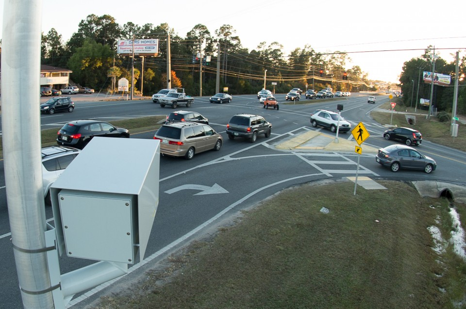 Studer Community InstituteTraffic passes the red light camera at Glover Lane and U.S. 90 in Milton. Michael Spooneybarger/ Pensacola Today