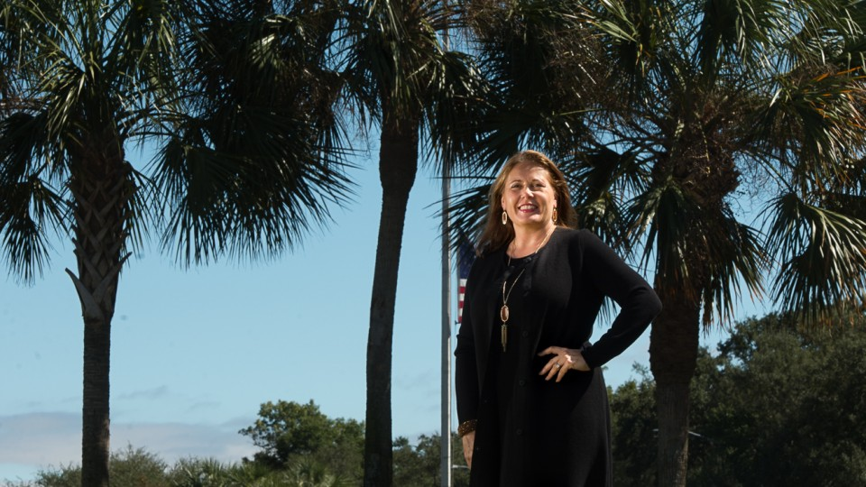 Woman standing in front of palm trees