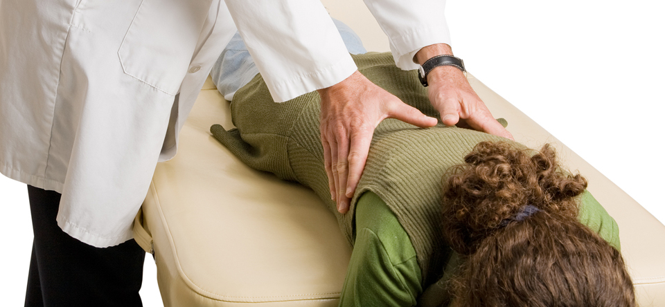 image of woman on massage table getting chiropractic massage