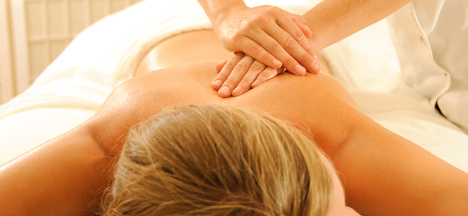 image of woman on massage table receiving massage