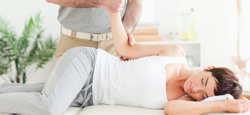 image of woman on massage table stretching arm