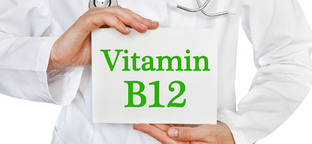 cropped image of doctor holding sign that says Vitamin B12