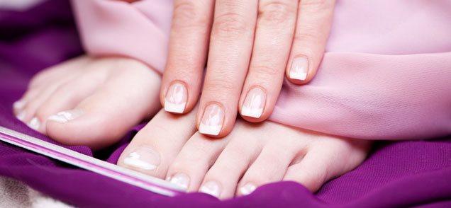 closeup image of woman's manicure & pedicure