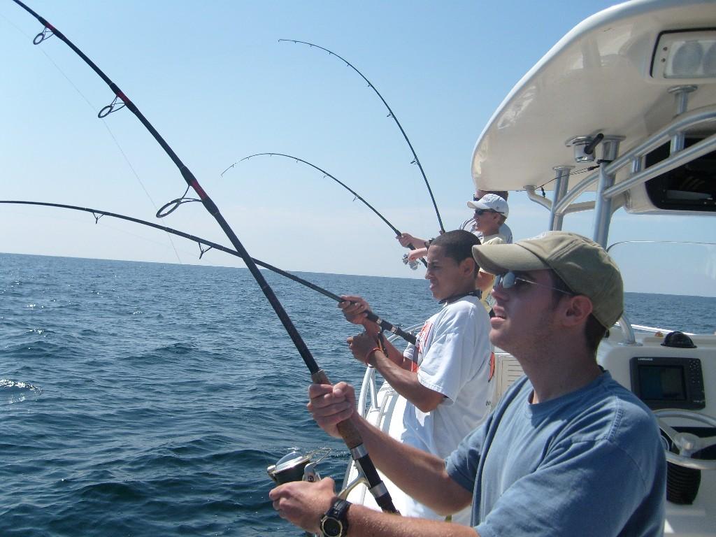 Men fishing from boat