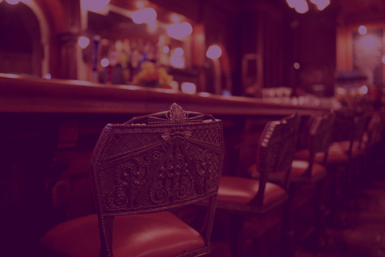 Empty chair at the bar at Palace Cafe