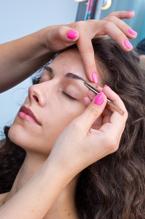 closeup of woman receiving eyebrow waxing