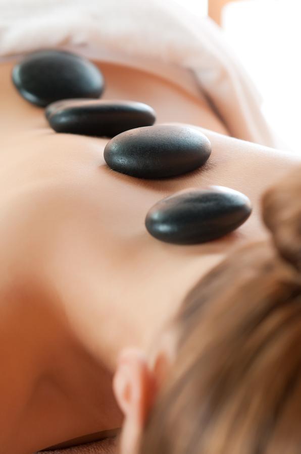 woman having Warm Stone Massage