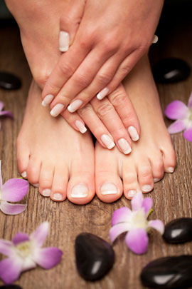 close up of woman's manicured hands and feet