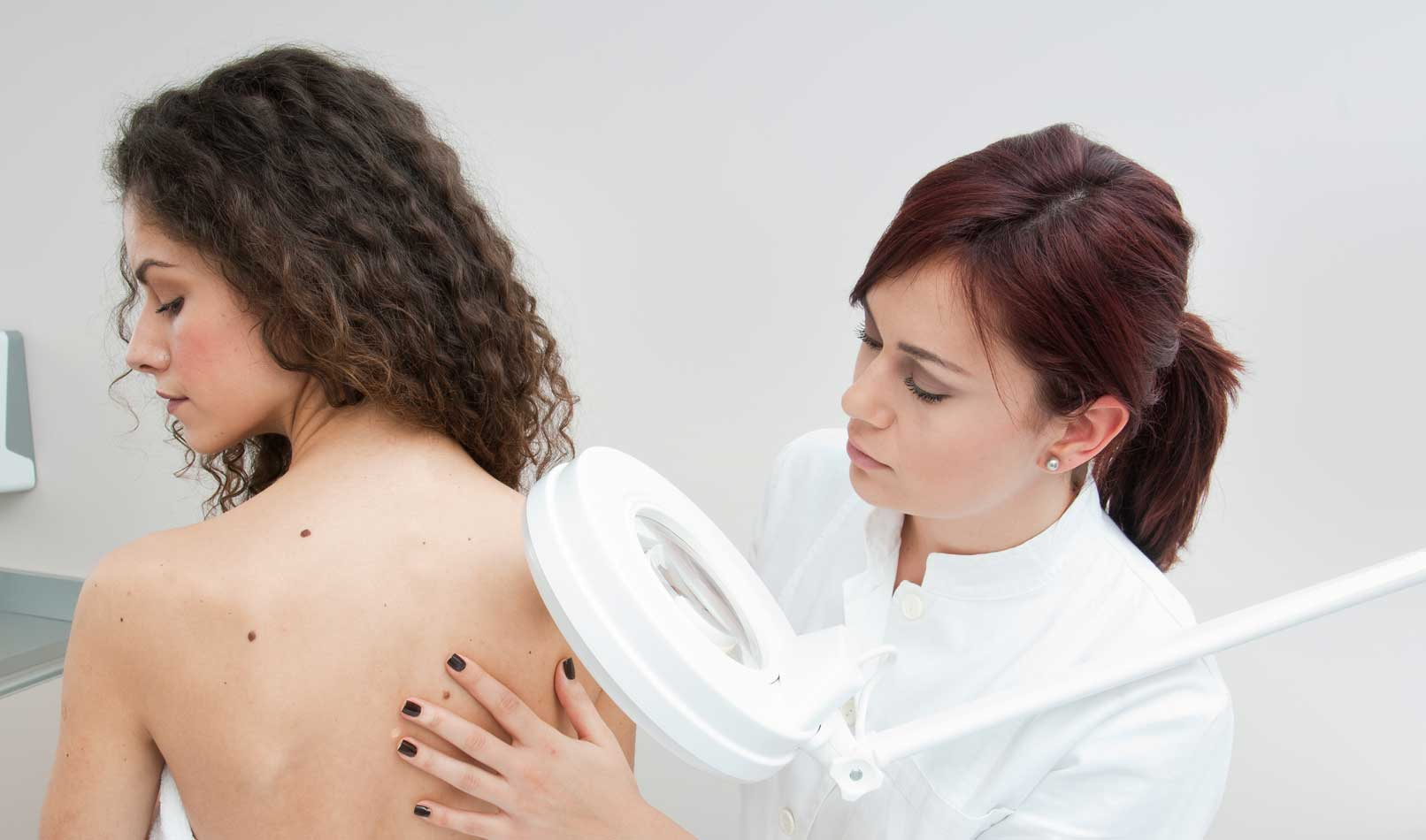 doctor-checking-patient-back