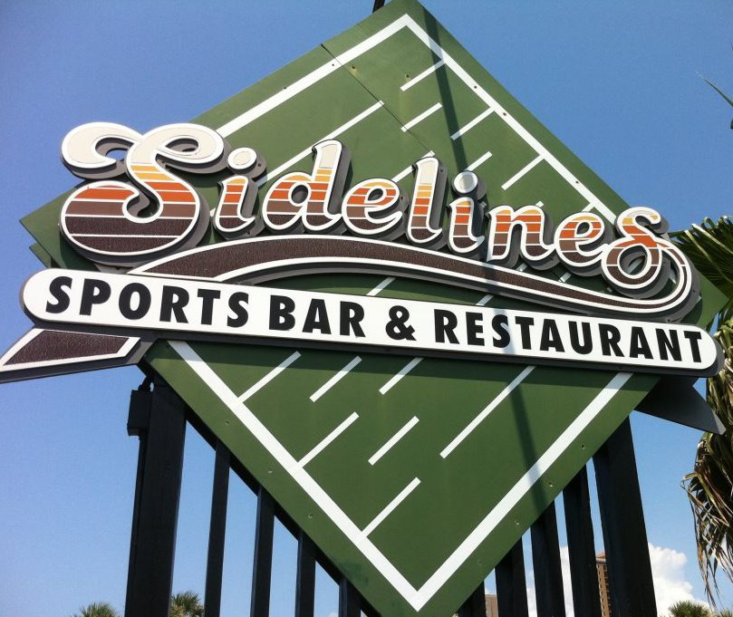 Sidelines Sports Bar and Restaurant Palm trees in Sunset Pensacola Beach