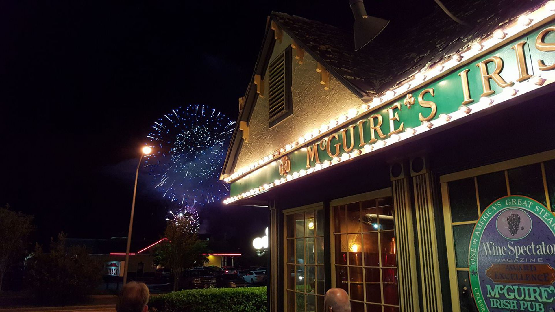 Front View of McGuires with Fireworks in the Background