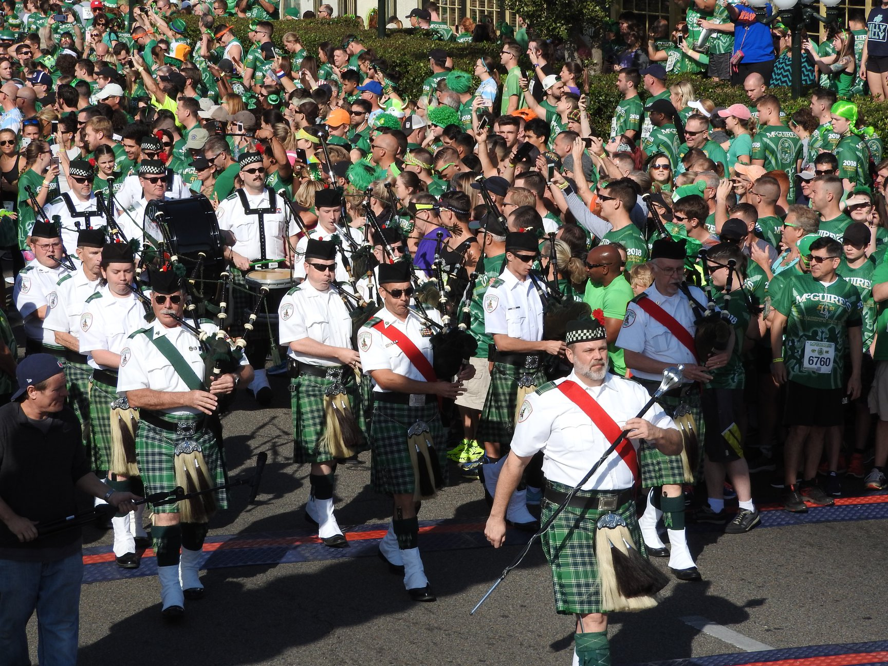 McGuire's Irish Pipe Band walking on street