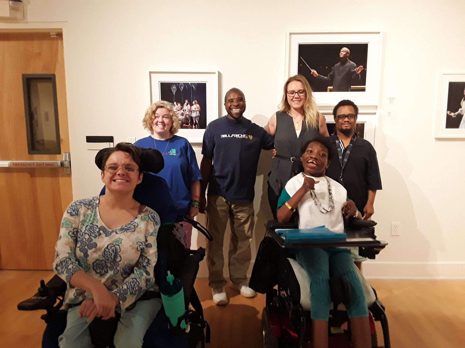 group of people at gallery exhibit