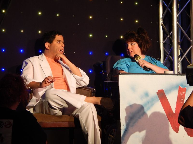 image of two people on stage sitting and talking