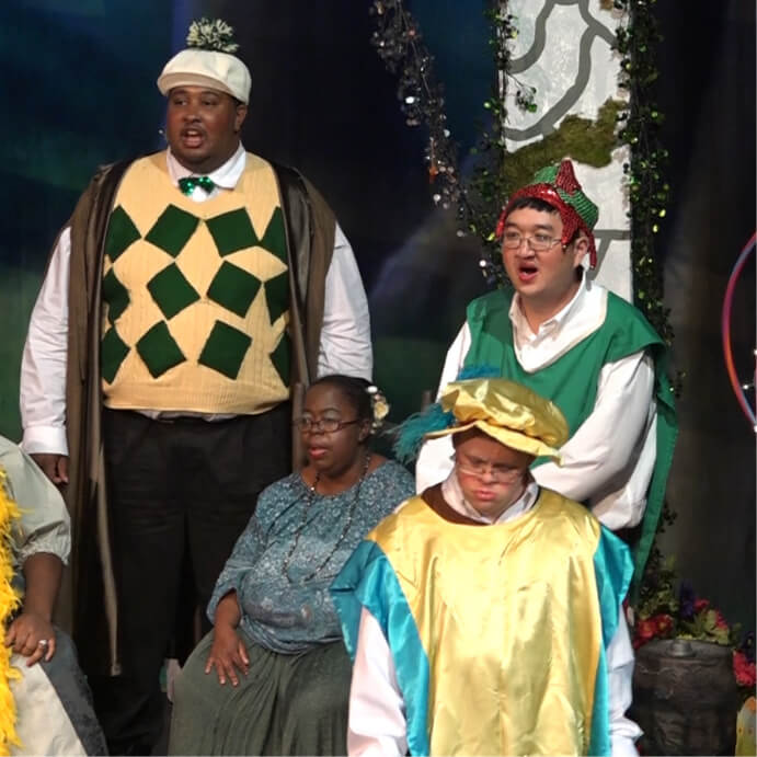 four characters from Spellbound on stage