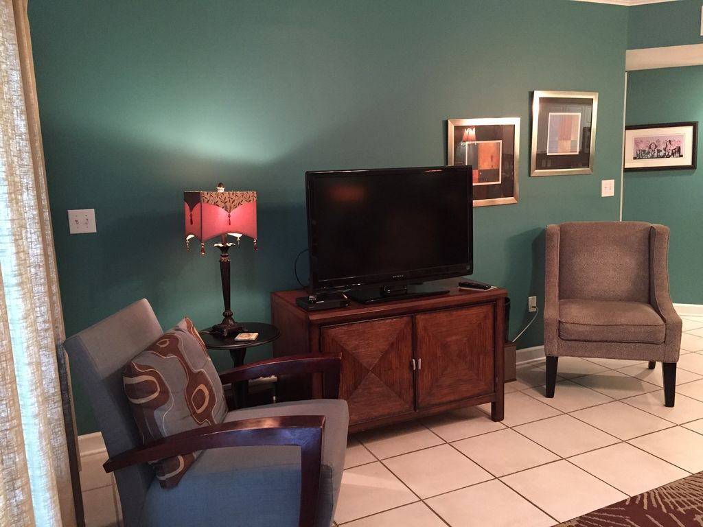 Living Room with Large Flat Screen TV, Blu Ray, and Stereo