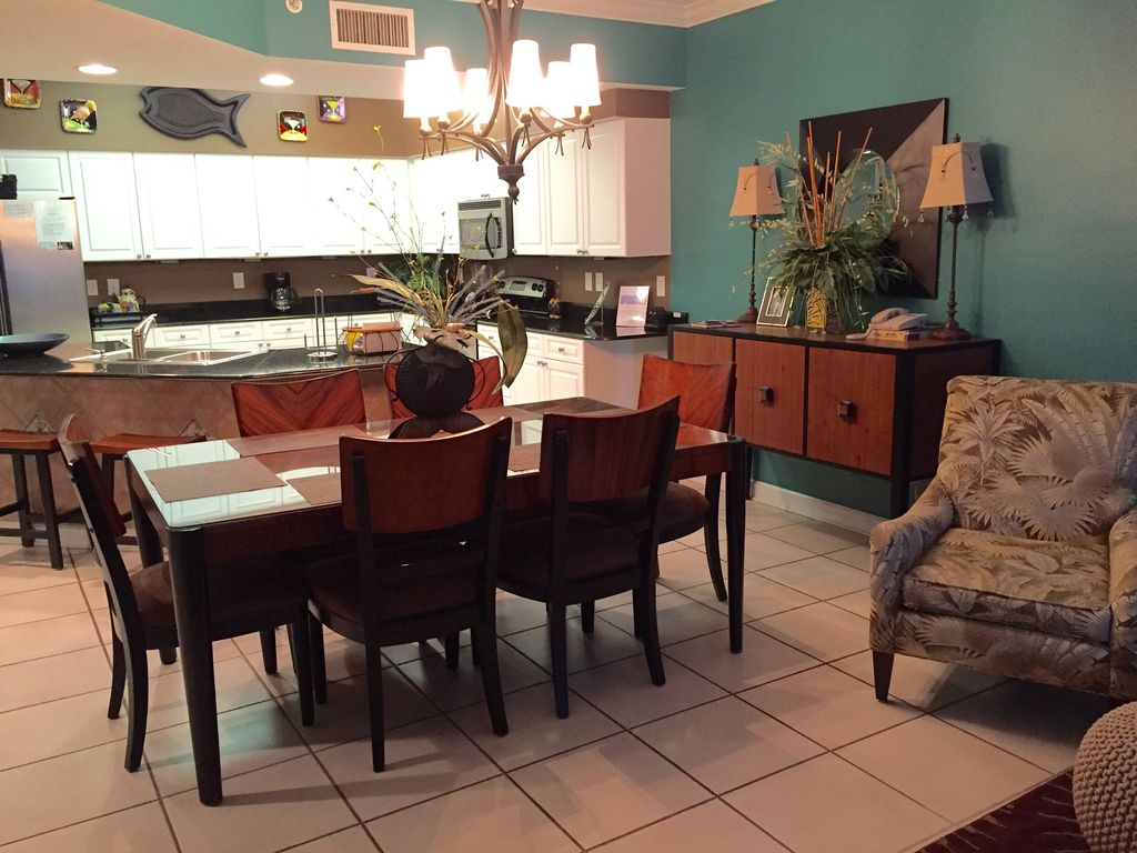 Dining Room with seating for 6, Spacious Stainless Steel Kitchen with Breakfast Bar