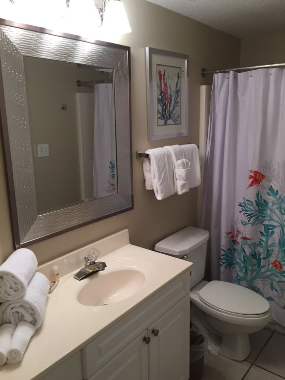 Queen Guest Bathroom which opens to Bedroom and Hallway for drop in Guests