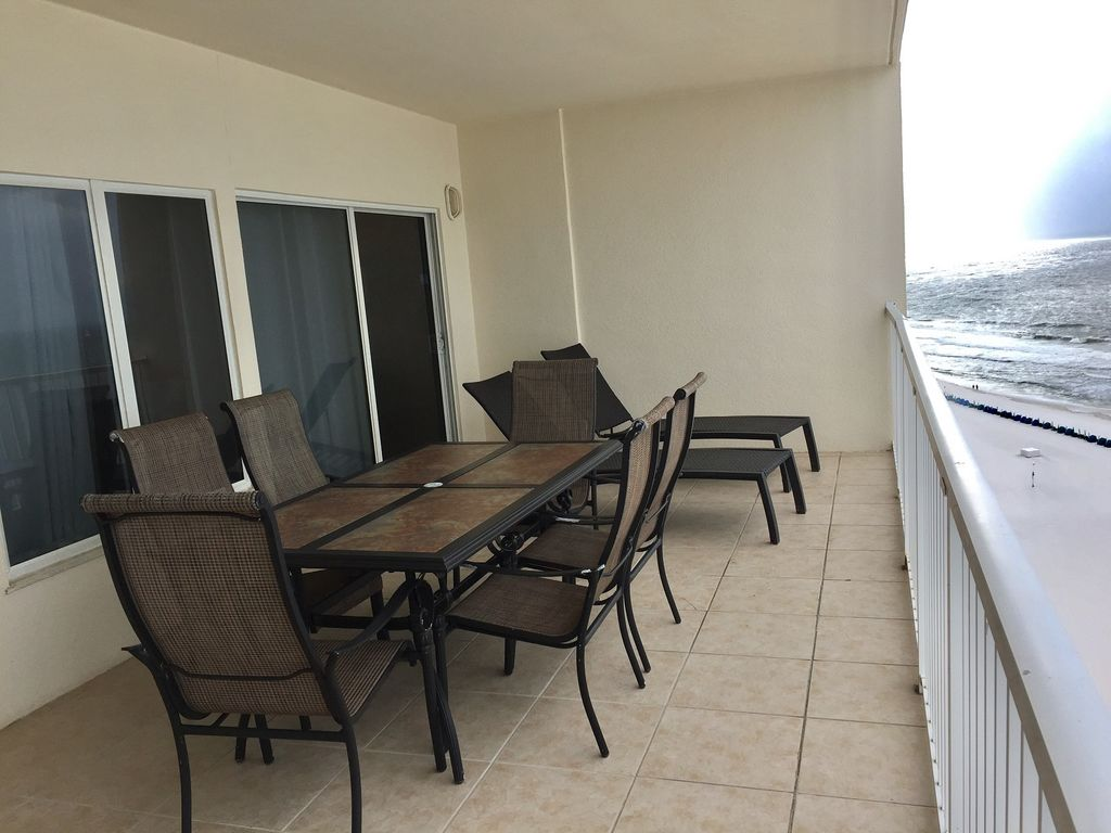 Spacious Gulf Front Balcony with Table and 6 Chairs and 2 loungers