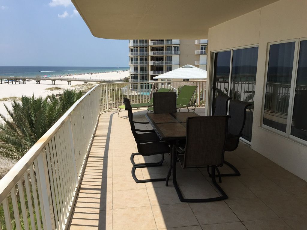 Large Gulf Front Balcony Table with Seating for 6 & 3 loungers
