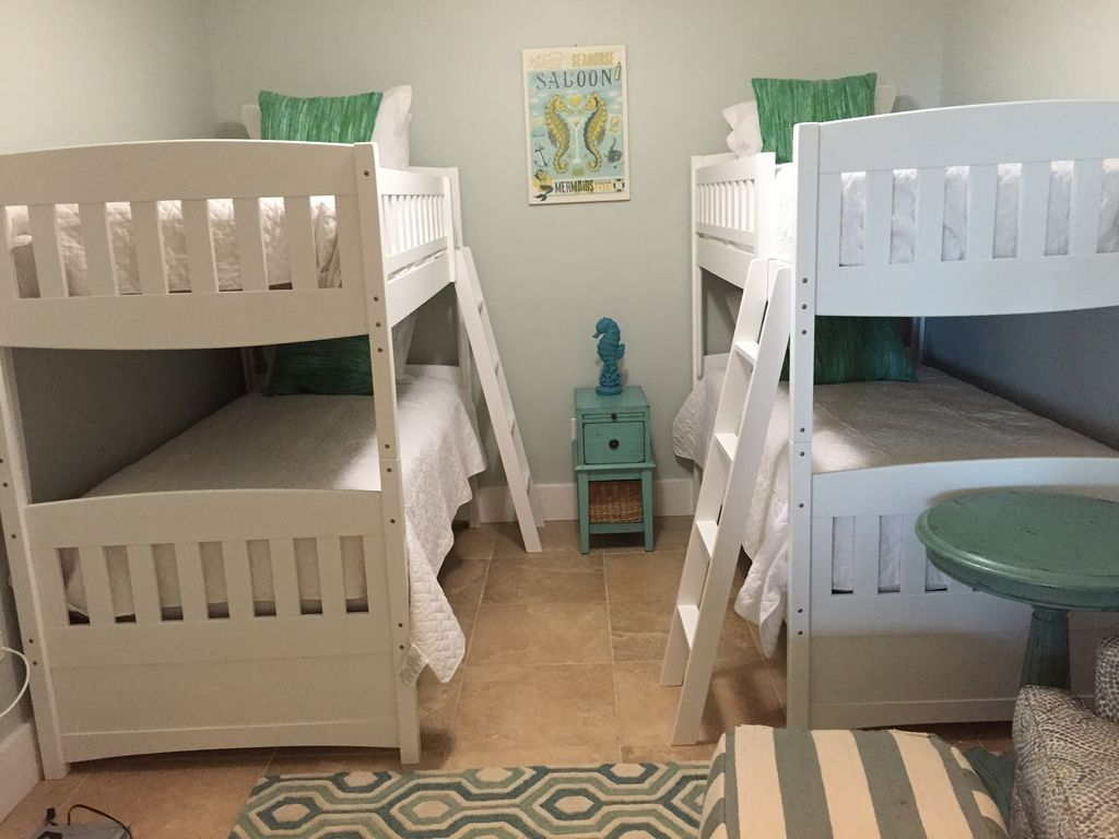 3rd guest bedroom with set of bunk beds and large HDTV and BluRay