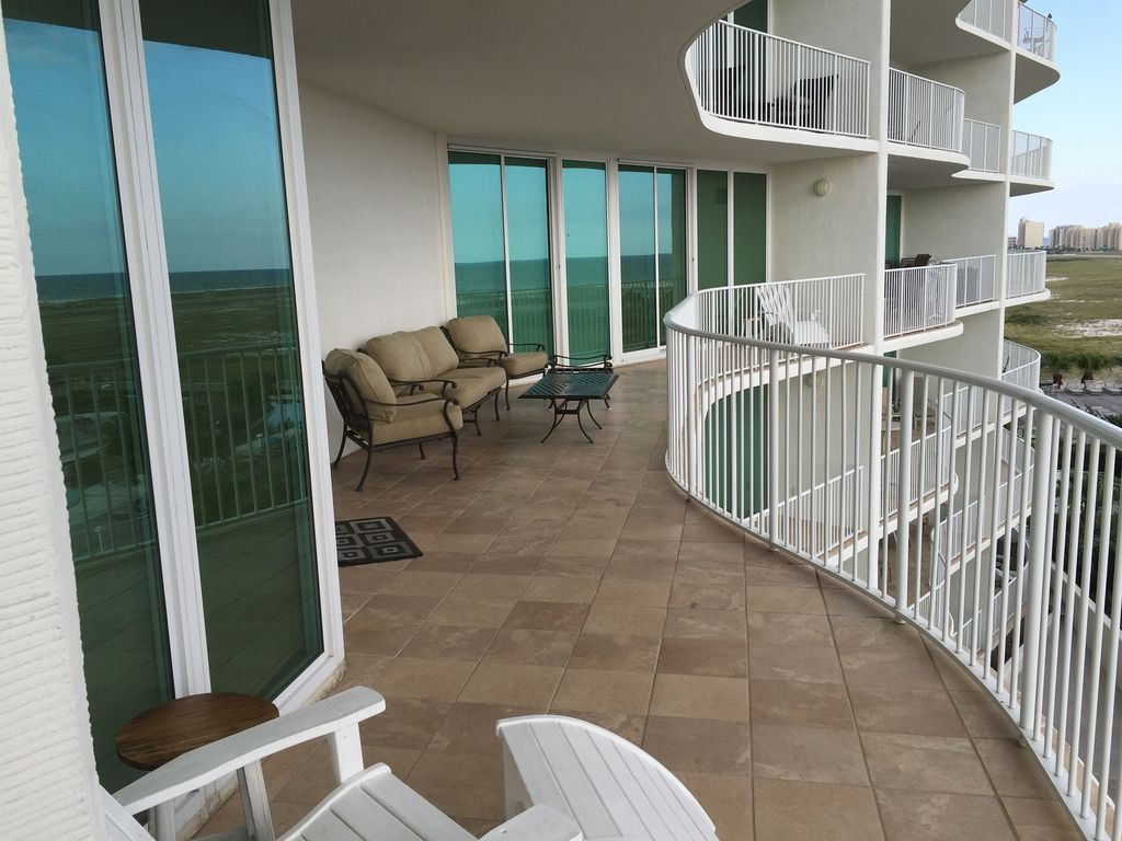 Balcony overlooking pools with view of Gulf of Mexico