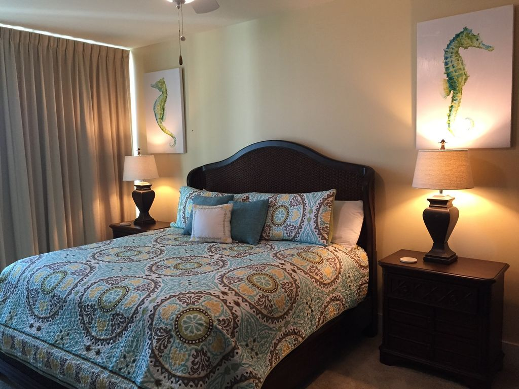 Caribe - Master bedroom with comfortable King Bed, doors open to gulfside balcony