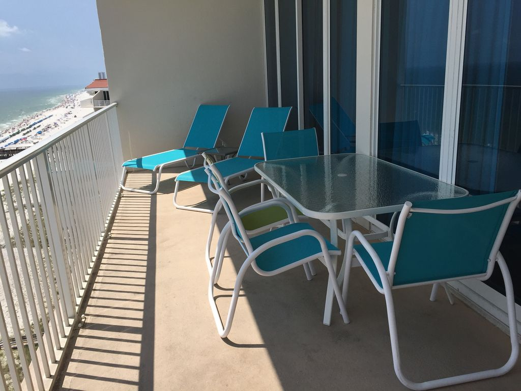 Spacious Gulf Front Balcony with Table and Chairs and 2 loungers