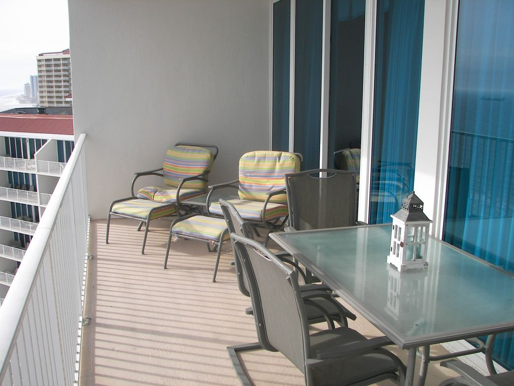Lighthouse- Large Balcony overlooking the white Sandy beach