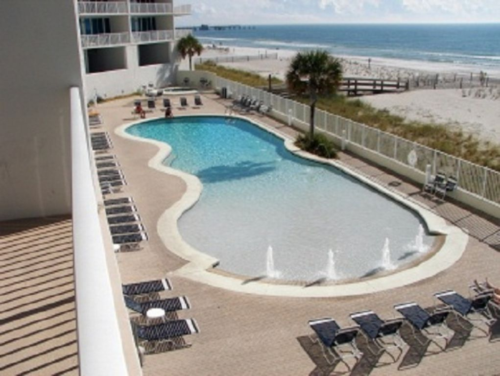 Large zero entry outdoor pool and hot tub at Lighthouse Condo
