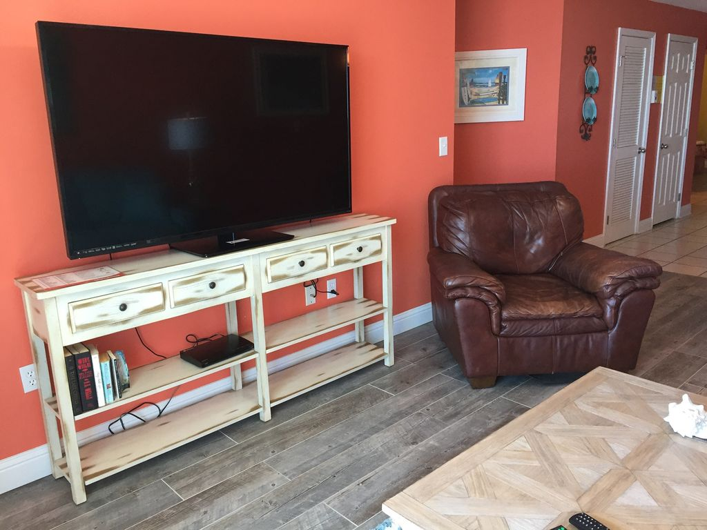 Living Room with 65 Inch TV & DVD