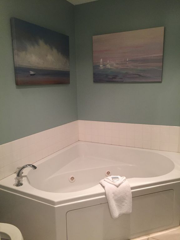 Master bath with jacuzzi tub and separate glass enclosed shower