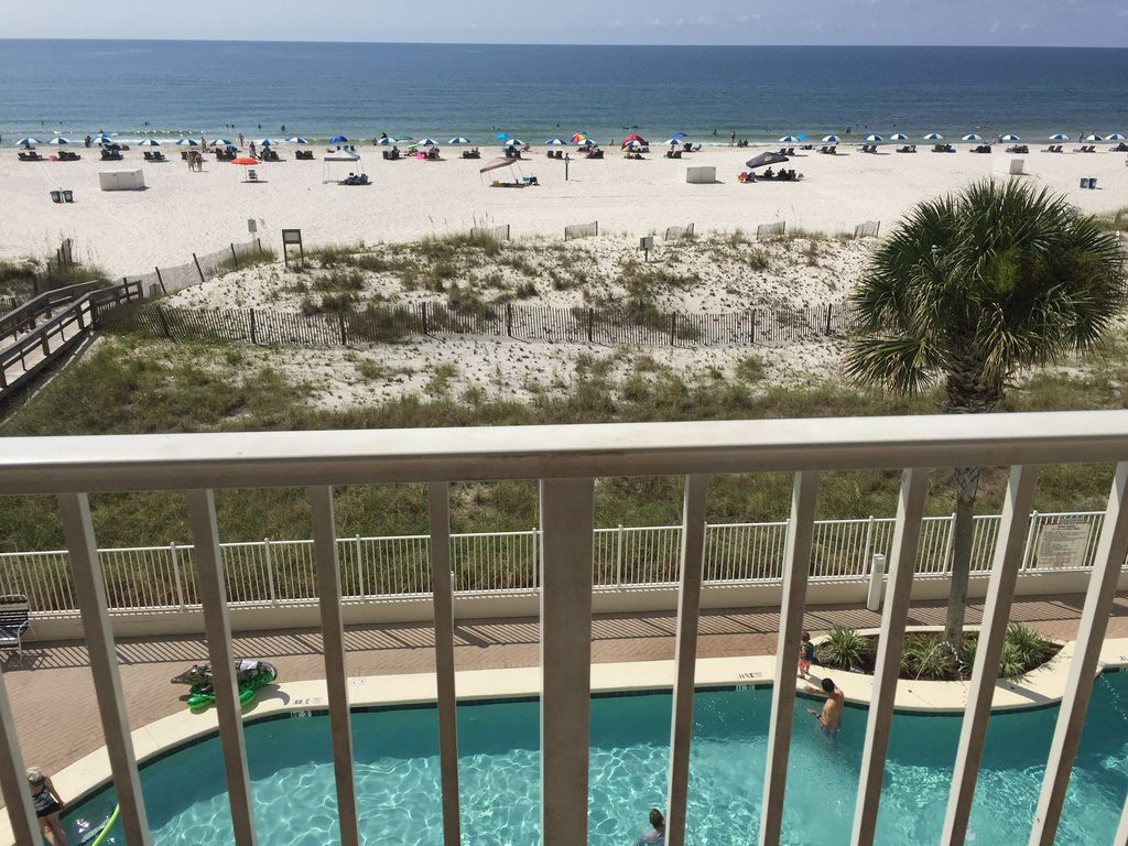 View from balcony of pools and white sandy beaches
