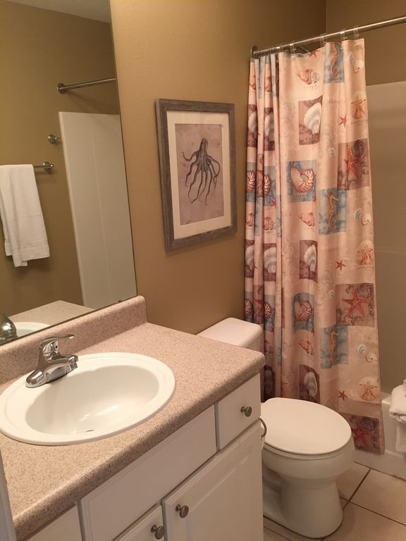 Guest Bath opening to Bedroom and Hallway