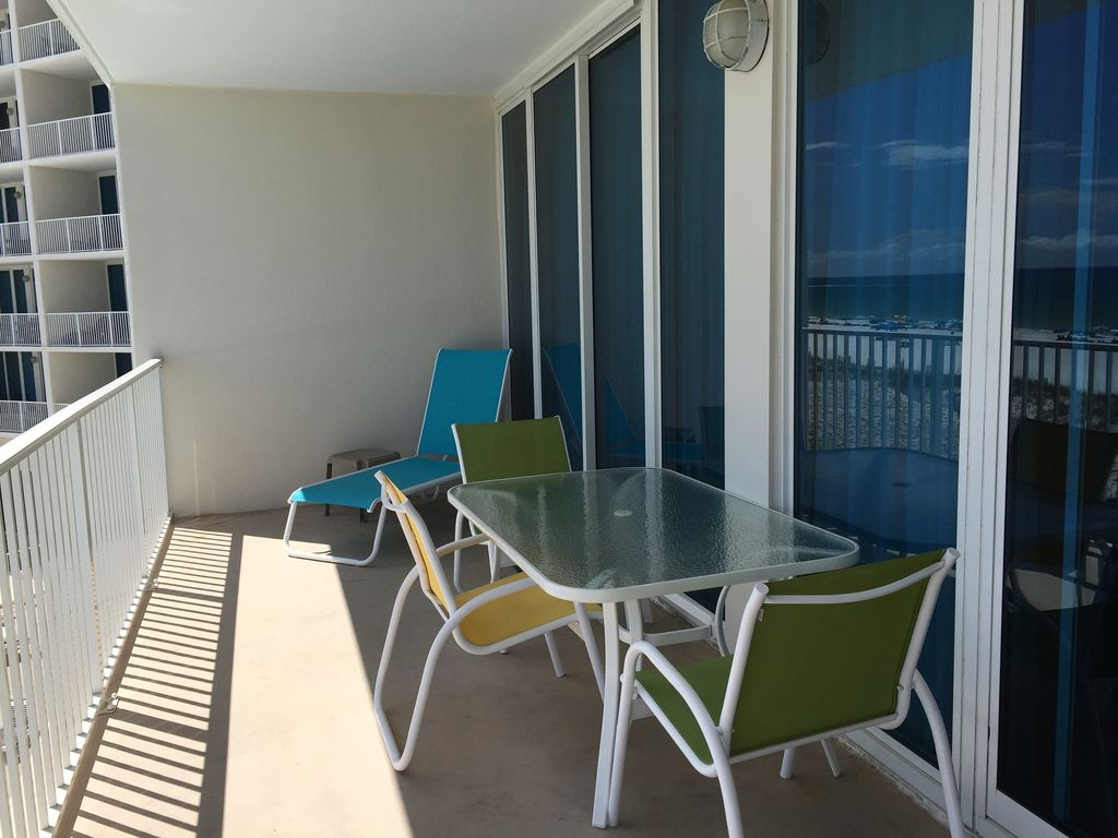 Large Gulf Front balcony with 6 chairs and loungers