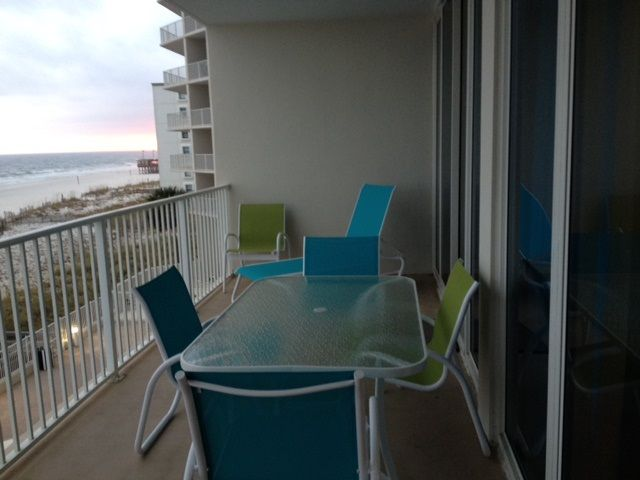 Large balcony with 6 chairs and lounger