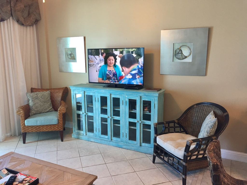 Living Room with 50 Inch Smart TV & DVD. Opens to Gulf Front Balcony