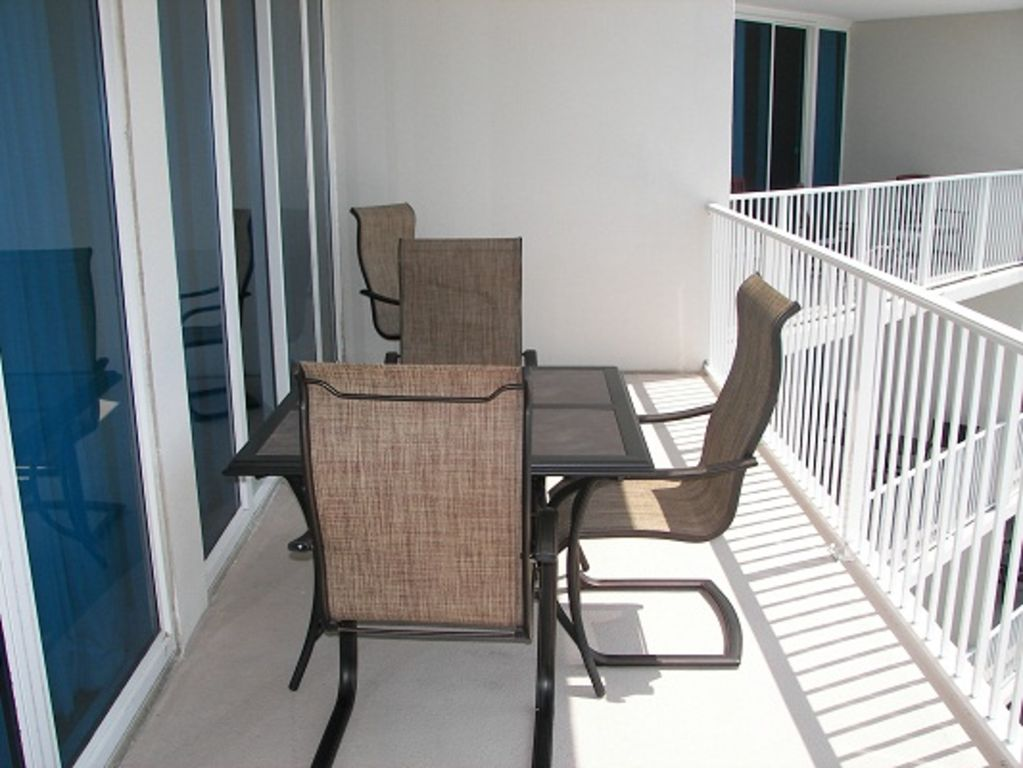 Table with seating for six overlooking the beach in front of Lighthouse Condo Complex