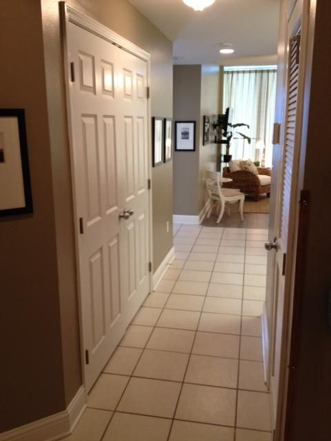 Hallway entering Condo with Full Size Washer & Dryer
