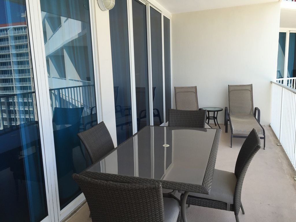 Large Gulf Front balcony with table & 4 chairs, and 2 loungers