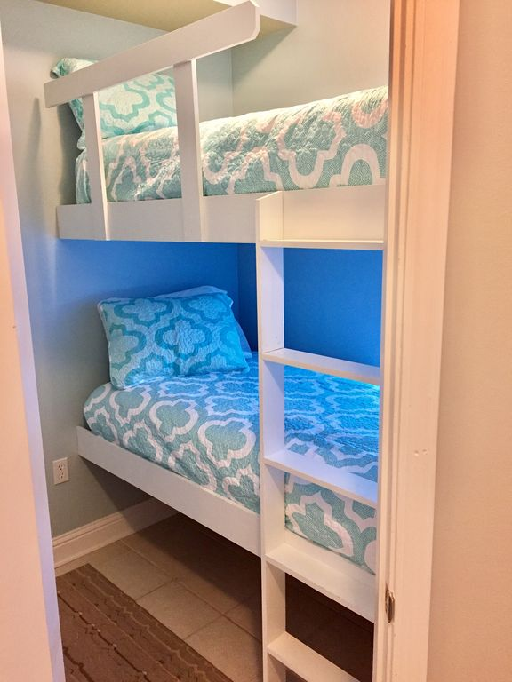 Bunk room with full size twins and tv with DVD