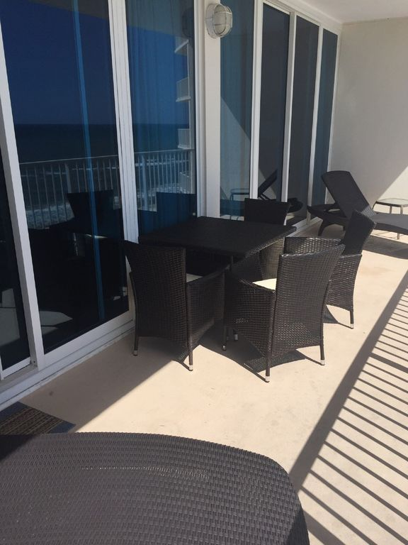 Balcony with Table and 4 chairs and lounger