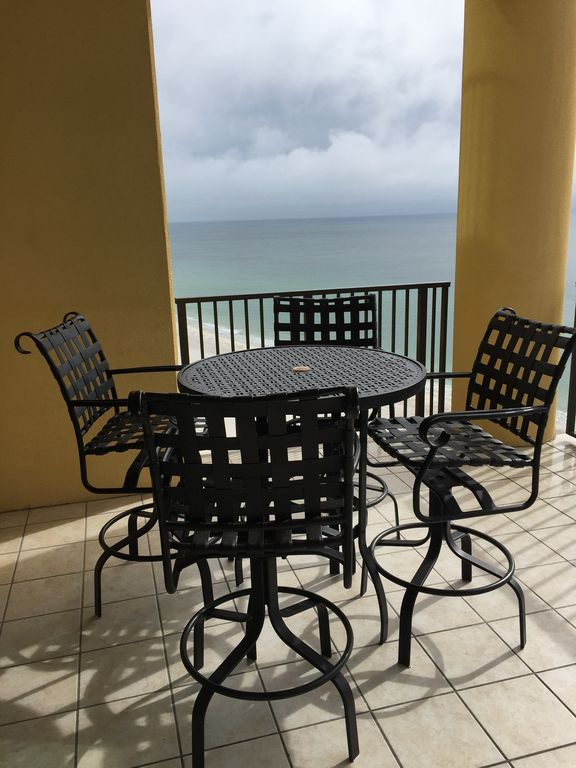 Table & Chairs on Gulf Front Balcony at Phoenix West II