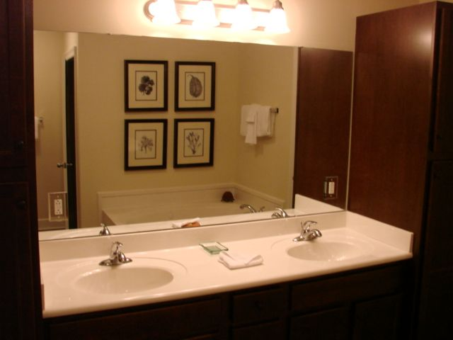Master bathroom Double Sinks with Jacuzzi Tub and his/her storage